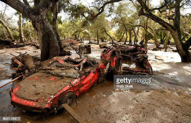 Mangled cars are stuck near Olive Mill Road in Montecito after a major storm hit the burn area Tuesday January 9 2018 in Montecito California