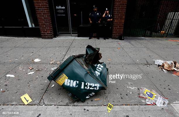 A mangled dumpster sits on the sidewalk at the site of an explosion that occurred on Saturday night on September 18 2016 in the Chelsea neighborhood...