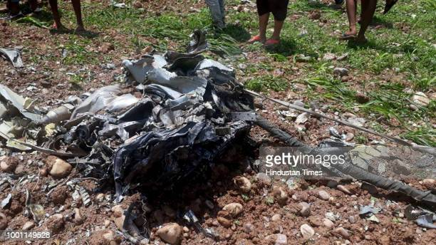 Mangled remains of a MiG21 fighter jet of Indian Air Force that crashed in the agricultural fields at Patta Jattian village on July 18 2018 in Kangra...