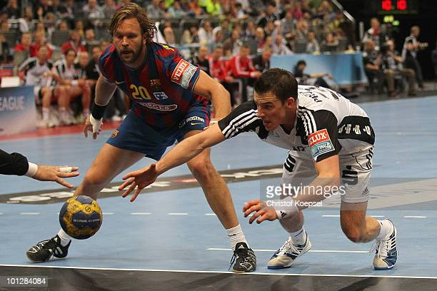 Mangnus Jernemyr of Barcelona Borges and Dominik Klein of Kiel fight for the ball during the handball final match between THW Kiel and FC Barcelona...
