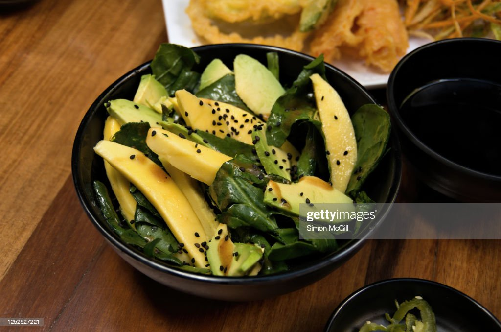 Mango, avocado and baby spinach salad with black sesame seeds : Stock Photo