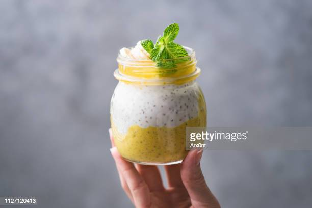 mango chia pudding in jar - mousse dessert stock pictures, royalty-free photos & images