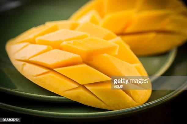Mango-Frucht und Mango Scheiben