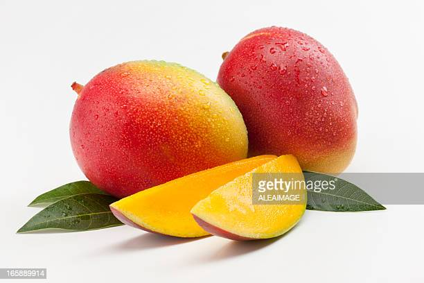 mango - tropical fruit stock pictures, royalty-free photos & images