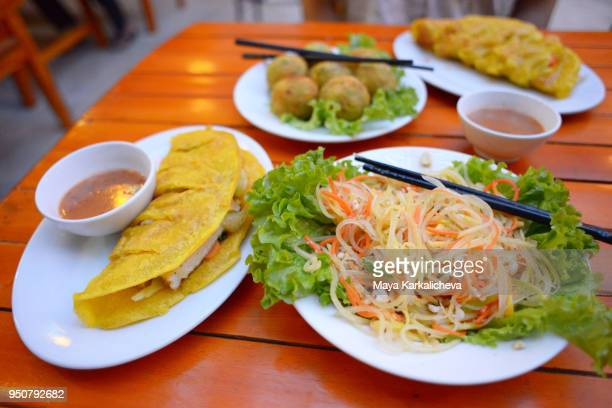 Mango salad and pancakes in Phong Nha restaurant, Vietnam