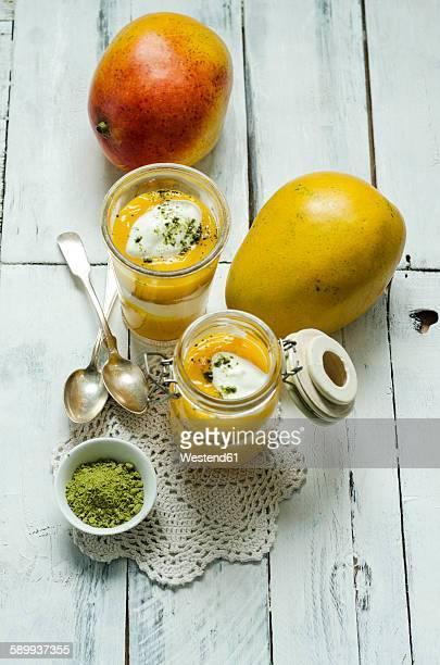 Mango yogurt dessert in glass, matcha powder