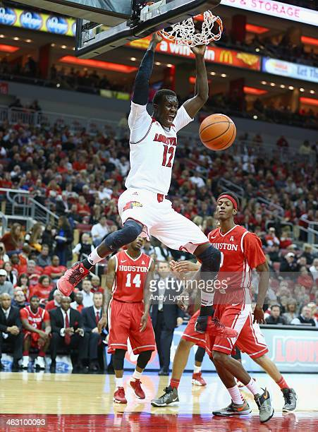 Mangok Mathiang of the Louisville Cardinals dunks the ball during the game against the Houston Cougars at KFC YUM Center on January 16 2014 in...