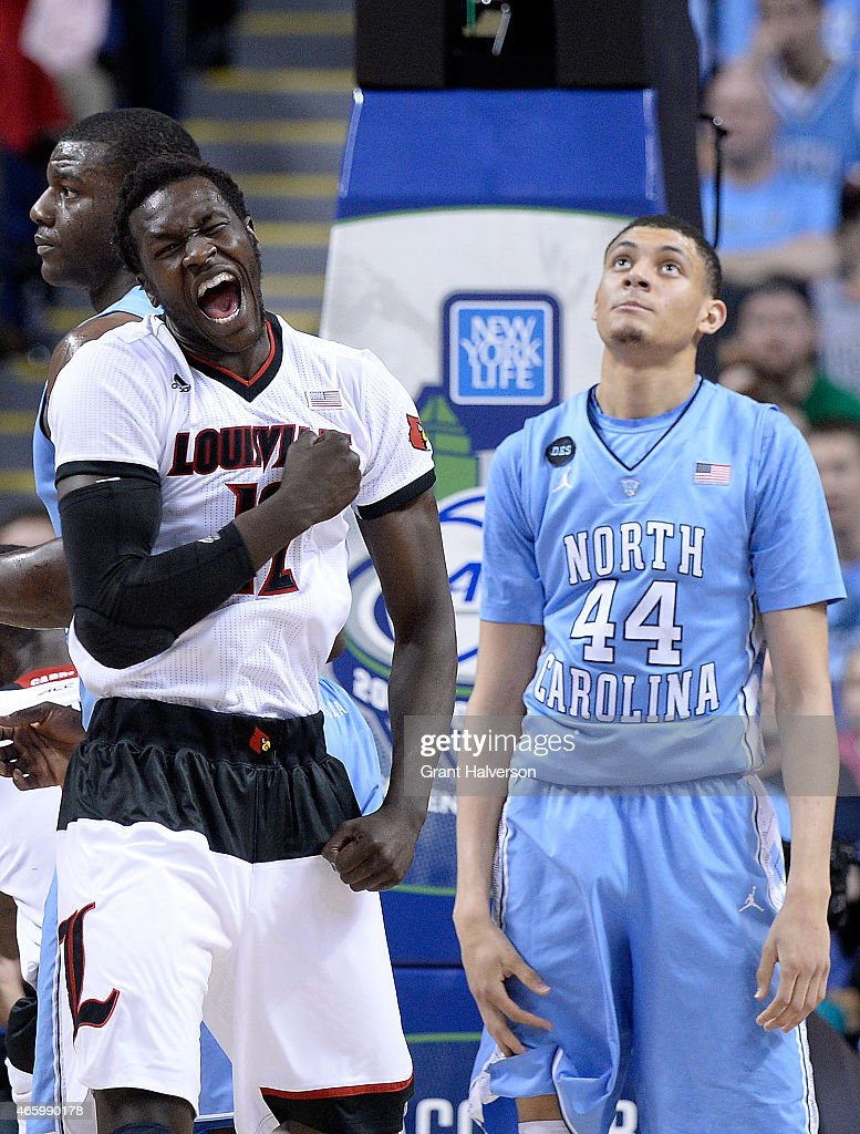 Mangok Mathiang #12 of the Louisville Cardinals reacts as Justin Jackson #44 of the North Carolina Tar Heels looks on during the quarterfinals of the ACC Basketball Tournament at Greensboro Coliseum on March 12, 2015 in Greensboro, North Carolina.