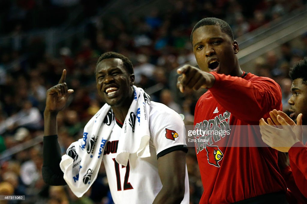 Mangok Mathiang #12 of the Louisville Cardinals reacts from the bench after points in the second half of the game against the Northern Iowa Panthers during the third round of the 2015 NCAA Men's Basketball Tournament at KeyArena on March 22, 2015 in Seattle, Washington.