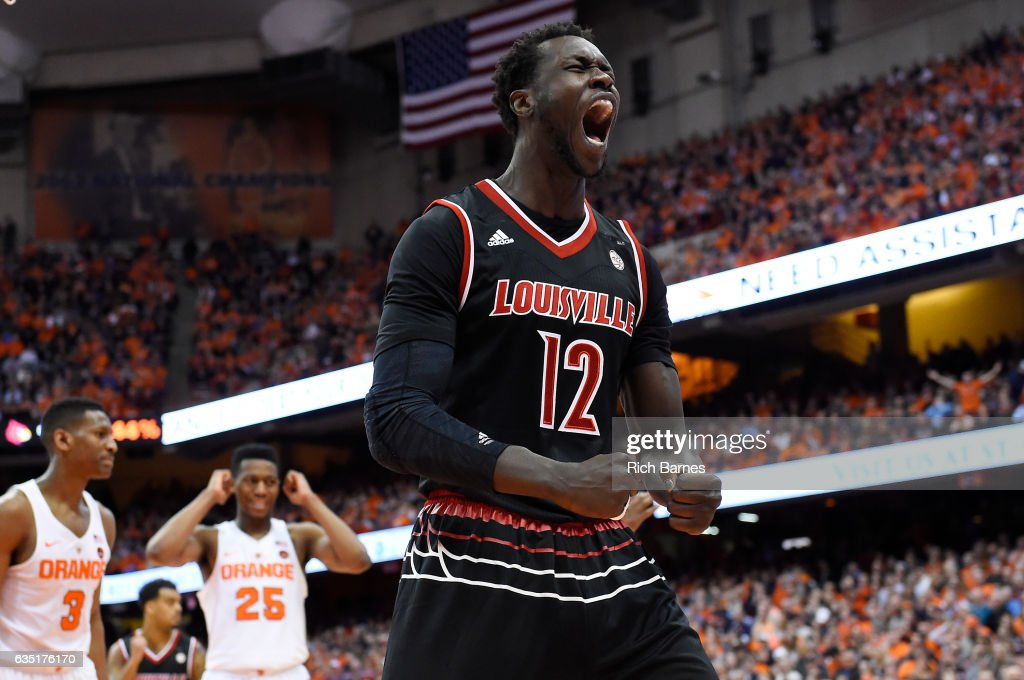 Mangok Mathiang #12 of the Louisville Cardinals reacts to a play against the Syracuse Orange during the second half at the Carrier Dome on February 13, 2017 in Syracuse, New York. Louisville defeated Syracuse 76-72 in overtime.