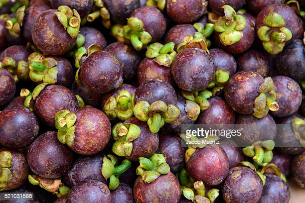 mangosteen fruit in market - mangosteen stock photos and pictures