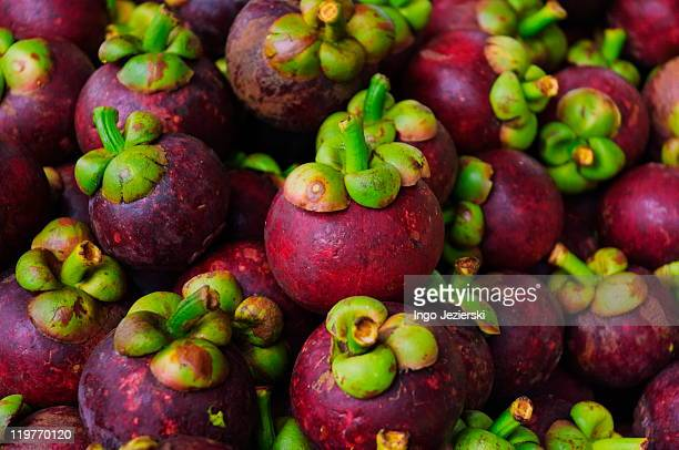 mangosteen fruit in thai market - mangosteen stock photos and pictures