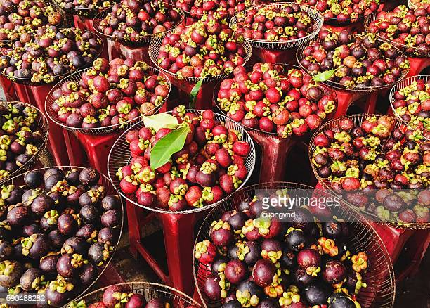 mangosteen, mangosteen in basket - mangosteen stock photos and pictures