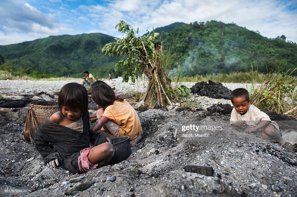 children collecting stones, mussel and snail shells and
