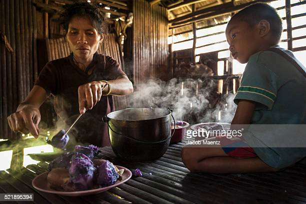 mangyan family cooking root crops. - filipino culture stock pictures, royalty-free photos & images