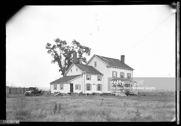 Manhasset / Roslyn / Little Neck / Douglaston / Alley Road Long Island unidentified wood house with car parked besdie and single tree behind New York...