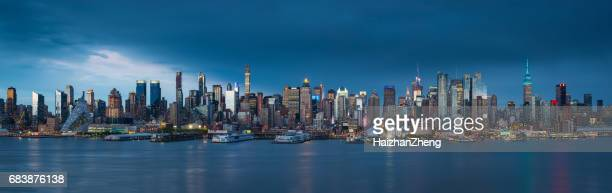 manhattan after sunset - new york skyline stock photos and pictures