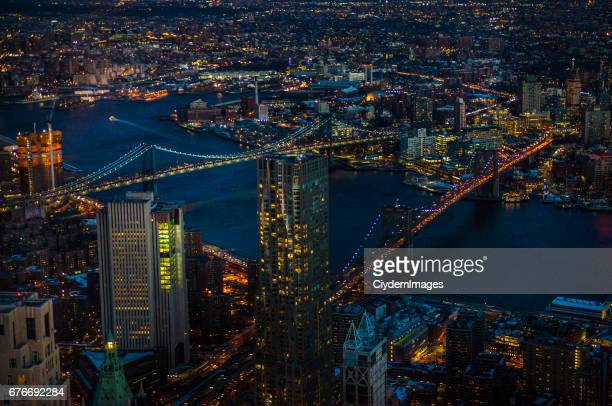 manhattan and brooklyn bridges via one world trade center observation point at night - queens new york city stock pictures, royalty-free photos & images