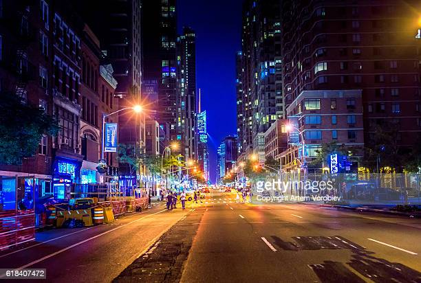 manhattan at night - chelsea new york stock photos and pictures