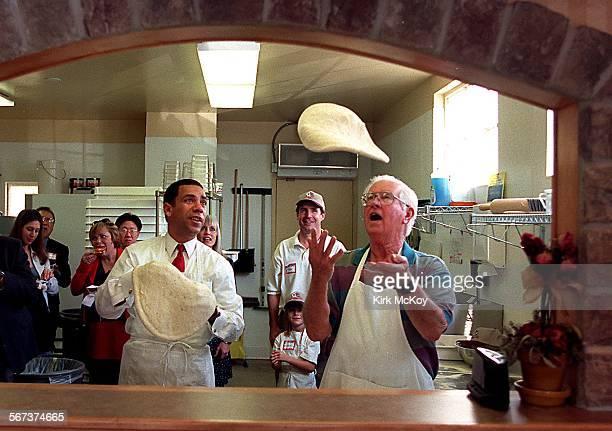 KM–– Manhattan Beach mayor Jack Cunningham tosses dough into the air at the opening of Tony Maroni's gourmet pizza Tony Rivera CEO of Tony Maroni's...