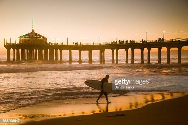Manhattan beach surfer silhouette