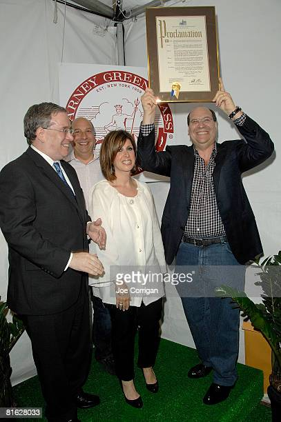 Manhattan Borough President Scott M Stringer presents Gary Greengrass with a Proclamation as Barney Greengrass and Sharon Greengrass join in at the...