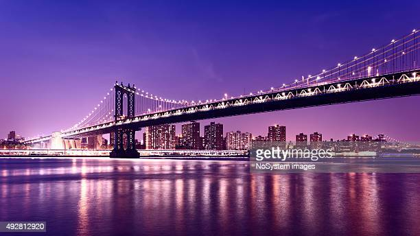 manhattan bridge and manhattan skyline at night, new york city - brooklyn bridge stock pictures, royalty-free photos & images