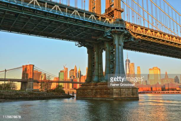 Manhattan Bridge at sunrise with Manhattan Skyline in background
