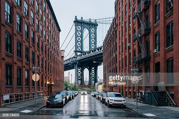 manhattan bridge in new york - empire state building stock pictures, royalty-free photos & images