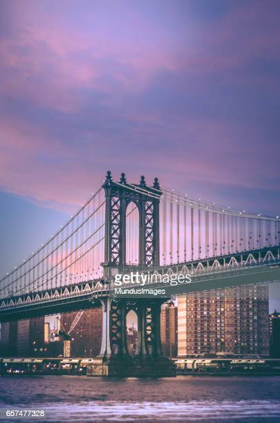 manhattan bridge of new york city at sunset - eastern usa stock photos and pictures