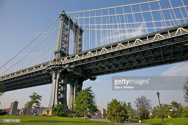 manhattan bridge pier and tower seen from fulton ferry park, dumbo, brooklyn, new york - dumbo stock photos and pictures