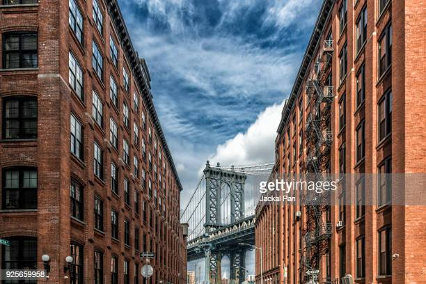 manhattan bridge seen from dumbo - dumbo stock photos and pictures