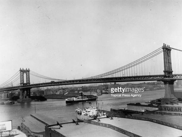 Manhattan Bridge spanning the East River between the boroughs of Manhattan and Brooklyn in New York City, opened 31 December 1909.