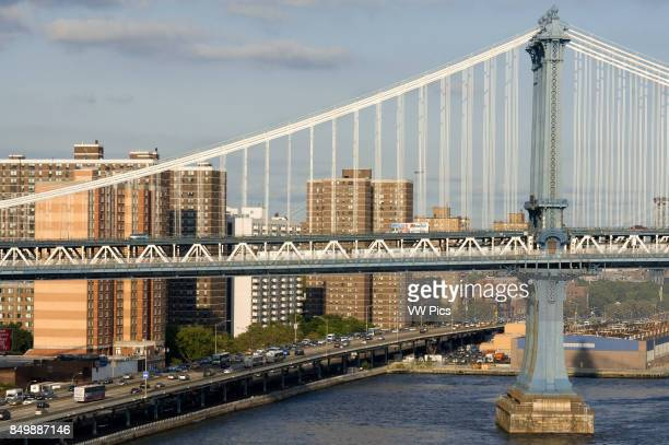 Manhattan Bridge The Manhattan Bridge is a suspension bridge that crosses the East River in New York City connecting Lower Manhattan with Brooklyn on...