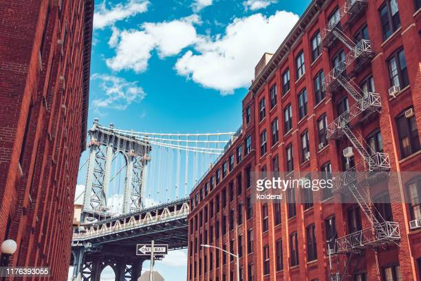 manhattan bridge view from dumbo neighborhood - lower east side manhattan stock pictures, royalty-free photos & images