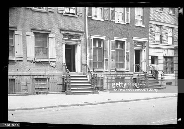 entrances to two unidentified townhouses 'To let / furnished apartment' sign on right hand building New York New York late 19th or early 20th century
