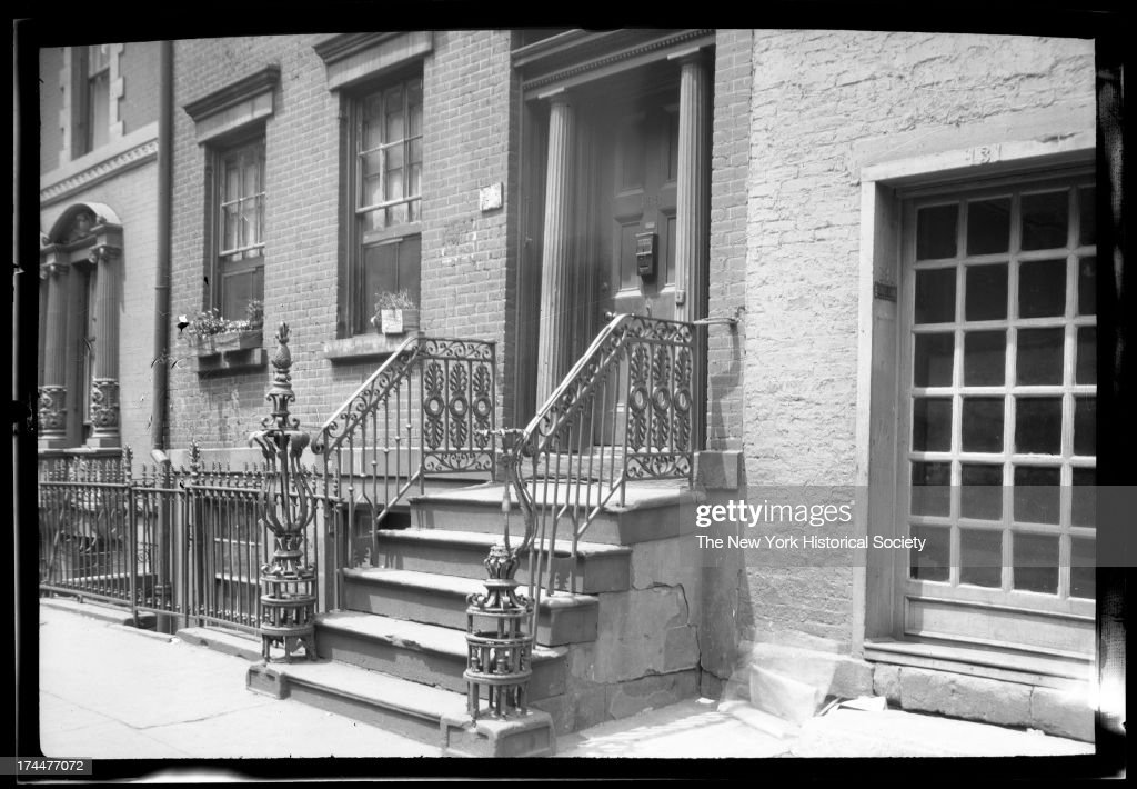 front door wrought iron railing and stoop of unidentified brick townhouse New York & Front Door Pictures   Getty Images