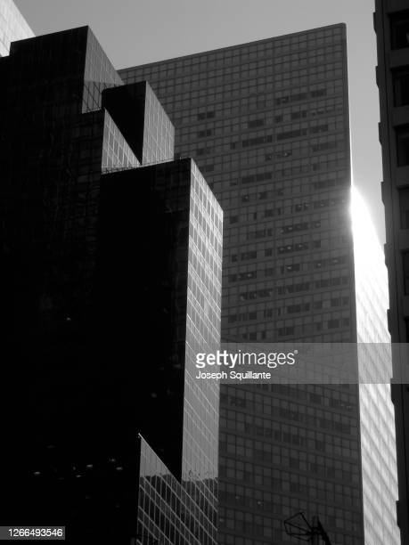 manhattan building facades in sunlight - joseph squillante stock pictures, royalty-free photos & images