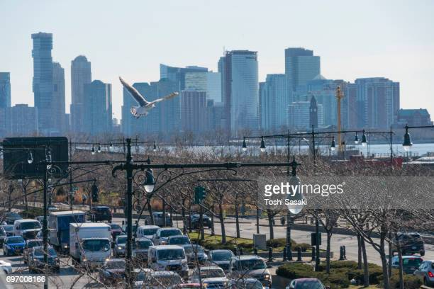 manhattan cityscape from high line park new york city on 2017. traffic congestion on west side highway and new jersey waterfront skyscrapers from high line park. - joe dimaggio highway stock photos and pictures