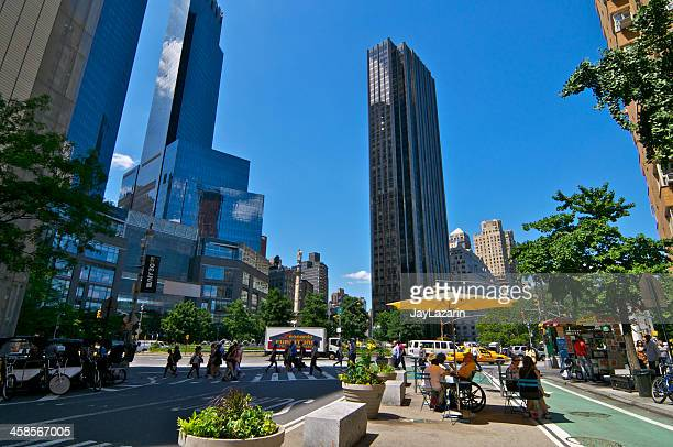 manhattan cityscape, people in columbus circle, , new york city - broadway manhattan stock photos and pictures