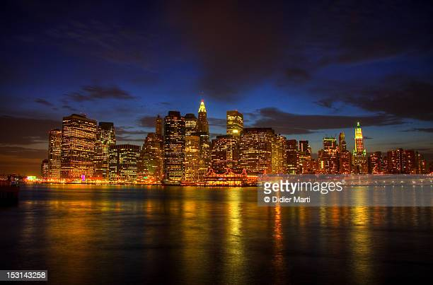 manhattan cityscape - didier marti stock photos and pictures