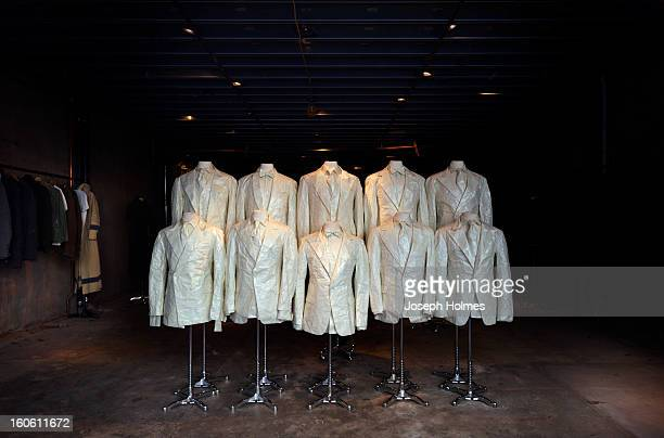 Manhattan clothing store window displays a whimsical array of suits and ties made entirely of paper in February 2012.