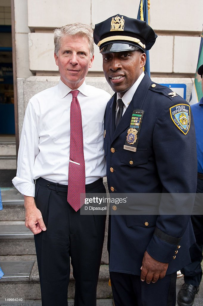 Manhattan District Attorney Cyrus R. Vance, Jr. (L) and New York Police Department Inspector Rodney Harrison attend National Night Out on the streets of Manhattan on August 7, 2012 in New York City.