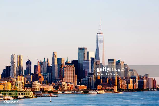 manhattan downtown skyline at sunset, new york, usa - new york city stock pictures, royalty-free photos & images