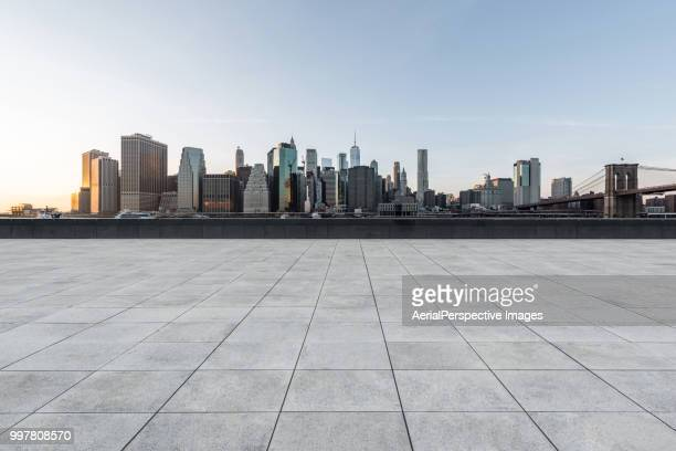 manhattan downtown skyline at sunset - マンハッタン ストックフォトと画像