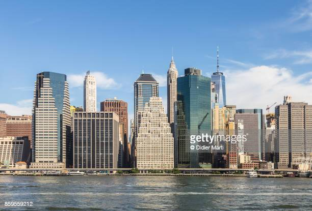 manhattan financial district in new york city - lower manhattan stock photos and pictures