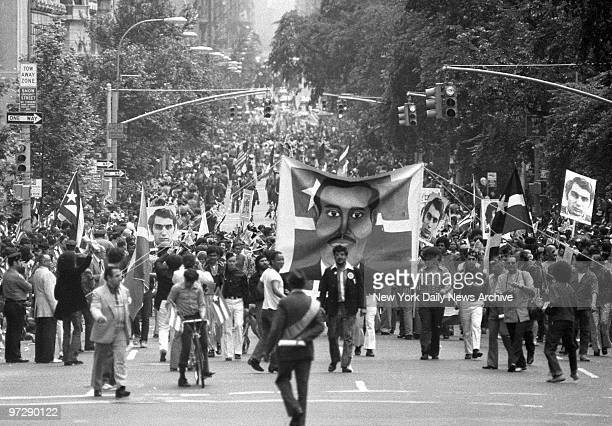 Manhattan goes Latin as young Hispanic-Americans carry banner depicting Puerto Rican nationalist hero Pedro Alibizu Campos up Fifth Ave. During...