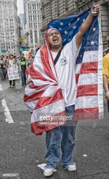 Manhattan Immigration rally seeking immigration law September 2007 Mexican wrapped in an AMERICAN FLAG