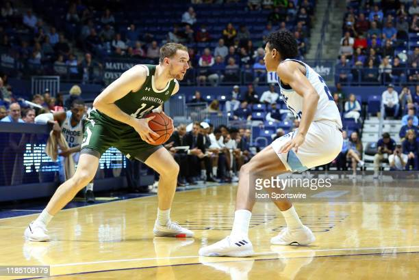 Manhattan Jaspers forward Tyler Reynolds and Rhode Island Rams forward Jacob Toppin in action during the college basketball game between Manhattan...