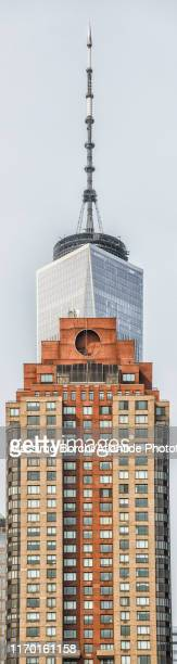 manhattan, lower manhattan, residential building and the upper part of the one world trade center skyscraper - image stock pictures, royalty-free photos & images